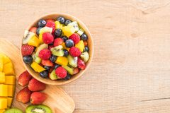 Mixed fresh fruits (strawberry, raspberry, blueberry, kiwi, mang. O) on wood bowl Stock Images