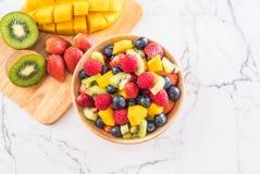 Mixed fresh fruits (strawberry, raspberry, blueberry, kiwi, mang. O) on wood bowl Royalty Free Stock Images