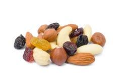Mixed fresh nuts and raisins. Isolated on white background Stock Photo