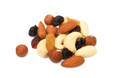 Mixed fresh nuts and raisins. On white background Royalty Free Stock Images