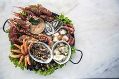 Mixed fresh seafood selection gourmet set platter meal on table. Mixed fresh portuguese seafood selection gourmet set platter meal on table Royalty Free Stock Photo