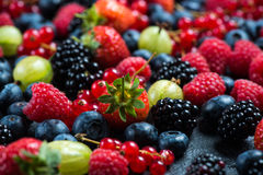 Mixed fresh ripe berries background Royalty Free Stock Images