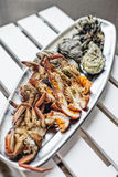 Mixed fresh seafood selection gourmet set platter meal on table Royalty Free Stock Photos