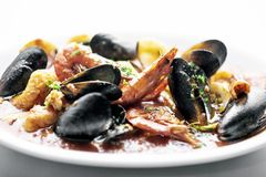 Mixed fresh seafood stew with prawns mussels scallops and clams Stock Photography
