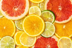 Free Mixed Fresh Slices Citrus Fruit As Background. Top View Stock Images - 129722164