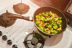Mixed fresh vegetables in a skillet. Broccoli on frying pan Stock Photo