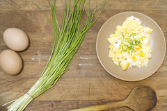 Mixed fried eggs on vintage board Stock Images