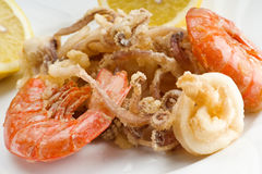 Mixed fried fish. Shrimp, squid and octopus Stock Photos