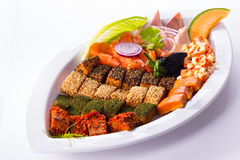 Mixed fried fish on white platter Stock Photography