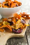 Mixed fried vegetable chips. Mixed fried vegetable chips on cutting board Stock Images