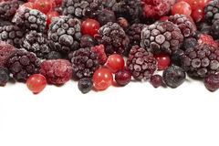 Mixed frozen berry fruits on white Royalty Free Stock Photography