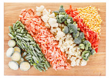 Mixed frozen vegetables on cutting board Royalty Free Stock Photos