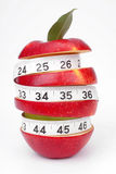 Mixed-fruit. And measuring tape on a white background Stock Photography