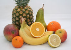 Mixed Fruit. Grouping of fresh fruit. Pineapple, mango, pear, oranges, lemon, apple and bananas stock photo