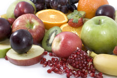 Mixed fruit. A wide mixture of fruit shot on a white background Royalty Free Stock Images