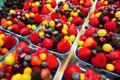Mixed fruit berries. Fresh mixed fruit berries close up background royalty free stock images