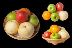 Mixed Fruit ,   on black background. Mixed Fruit , Oranges, apples, pomegranates  on black background Stock Photo