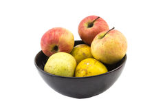 Mixed fruit in black bowl still life on white background Royalty Free Stock Image