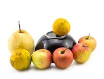 Mixed fruit with black bowl still life on white background Stock Photos