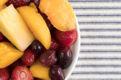 Mixed fruit in a bowl on a tablecloth Stock Images