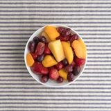 Mixed fruit in a bowl on a tablecloth Stock Image