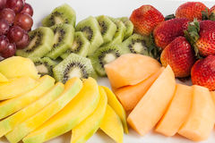 Mixed fruit chopped. Fresh and tasty mixture of chopped fruit Royalty Free Stock Images