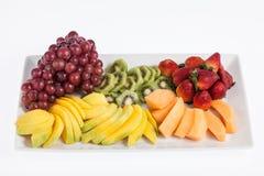 Mixed fruit chopped. Fresh and tasty mixture of chopped fruit Stock Photo