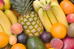 Mixed fruit closeup. Pineapple, banana, orange, plum, peach, apple Stock Image