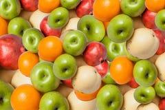Mixed Fruit ,  color full background. Mixed Fruit , Oranges, apples, pomegranates , color full background Stock Photo