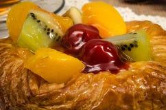Mixed fruit Danish pastry. Image of mixed fruit danish pastry in white dish Royalty Free Stock Photo