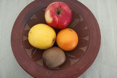 Mixed fruit inside a ceramic plate royalty free stock photo
