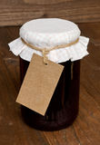 Mixed fruit jam jar with tag Royalty Free Stock Photo