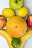 Mixed fruit. Laying on a wet white background Royalty Free Stock Images