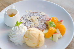 Mixed fruit pancake with ice cream and honey Royalty Free Stock Images