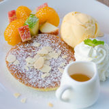 Mixed fruit pancake with ice cream and honey Royalty Free Stock Photography