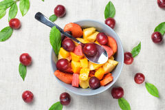 Mixed fruit salad in the blue bowl. stock image