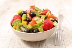 Mixed fruit salad. With strawberry, grape, kiwi and banana royalty free stock images
