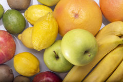 Mixed fruit. Mixed tropical fruit banana apple green leomon lime Stock Photo