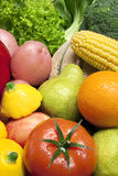 Mixed Fruit and Vegetables. A mix of fresh fruit and vegetables sprayed with water Stock Images