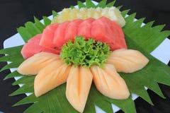 Mixed Fruit. Watermelon pineapple cantaloupe sweet fresh fruit from the farm stock photo