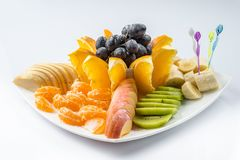 Mixed fruit in white plate  on white background - Healthy food style stock photos