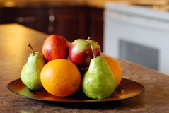 Mixed fruit on wood plate Royalty Free Stock Photo