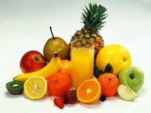 Mixed fruits. Fruits on table with glass of juice royalty free stock image