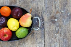 Mixed fruits of apples, lime, lemon, pears and plums in metal tray Royalty Free Stock Photography