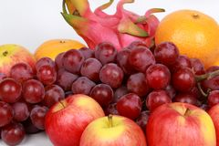 Mixed fruits as Red seedless grapes,orange,apple,Dragon fruit,Ja Royalty Free Stock Images