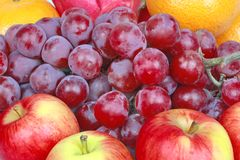Mixed fruits as Red seedless grapes,orange,apple,Dragon fruit,Ja Royalty Free Stock Image