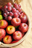 Mixed fruits in the basket. Apples and grapes in the basket Royalty Free Stock Image