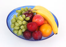 Mixed fruits in a blue bowl Royalty Free Stock Photo