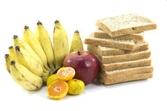 Mixed Fruits and Bread on white background. Mixed Fruits include Red ripe apple  banana oranges and Bread wheat Stock Photo