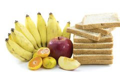Mixed Fruits and Bread on white background. Mixed Fruits include Red ripe apple  banana oranges and Bread wheat Stock Images